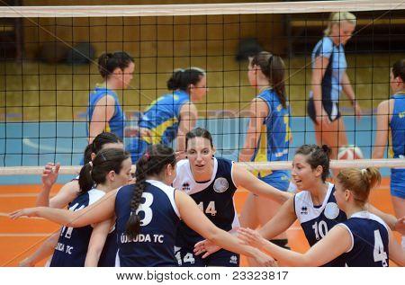 KAPOSVAR, HUNGARY - APRIL 24: Ujbuda players celebrate at the Hungarian NB I. League woman volleyball game Kaposvar (blue) vs Ujbuda (black), April 24, 2011 in Kaposvar, Hungary.
