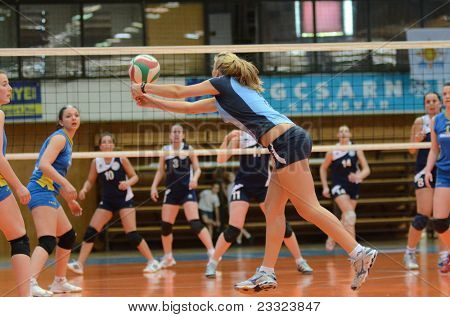KAPOSVAR, HUNGARY - APRIL 24: Zsofia Horvath (with ball) in action at the Hungarian NB I. League woman volleyball game Kaposvar (blue) vs Ujbuda (black), April 24, 2011 in Kaposvar, Hungary.