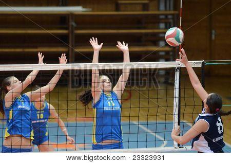 KAPOSVAR, HUNGARY - APRIL 24: Unidentified players in action at the Hungarian NB I. League woman volleyball game Kaposvar (blue) vs Ujbuda (black), April 24, 2011 in Kaposvar, Hungary.