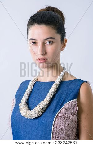 Beautiful Woman Portrait With A Paper Necklace