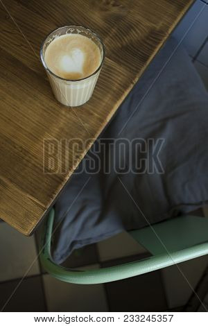 Invigorating Morning Latte On A Wooden Table
