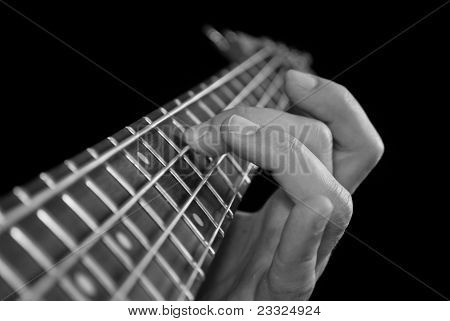 Fingers On Guitar Fretboard