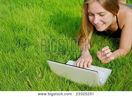 Girl With Netbook In Park