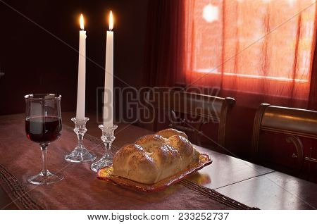 Shabbat Celebration Or Observance With Challah, Two Lit Tapered Candles, Glass Of Red Wine, At Sundo