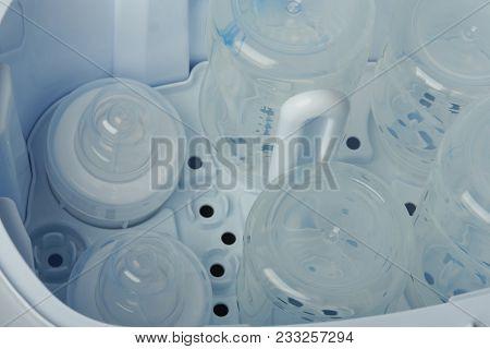 Clean Part Of  Plastic Bottles In Sterilizing Machine