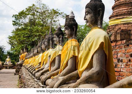 Buddha Statues In A Row Located At Wat Yai Chai Mong Kol, Ayutthaya Province, Thailand
