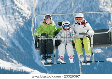 Ski lift - family on ski vacation