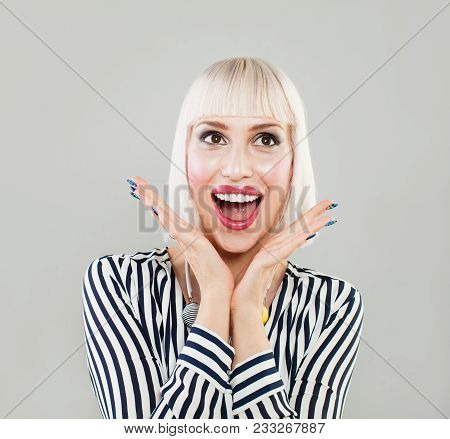 Woman Surprise Holds Hand By Cheeks. Beautiful Girl With Bob Hairstyle Surprised And Shocked Looks A