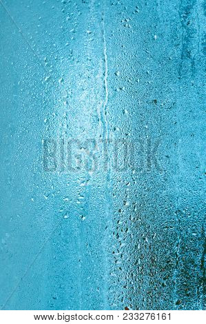 Frozen Glass Of Window From Inside Of Room. Background In Cool Tone With Texture Of Dripping Water D