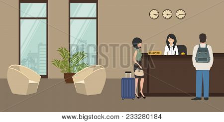 Hotel Reception. Young Woman Receptionist Stands At Reception Desk. There Are Also Two Armchairs On