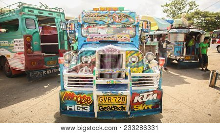 Jeepney Is The Most Popular Public Transport In The Philippines. Colorfully Decorated Jeeps Serve To