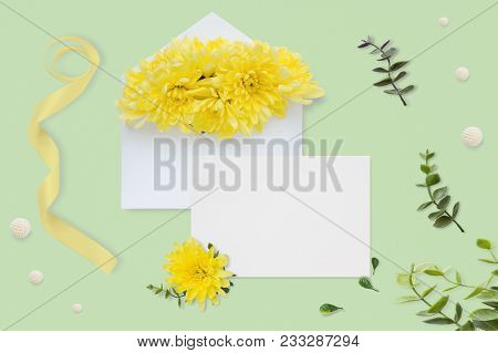 Letter, Envelope And A Present On Pastel Green Background. Wedding Invitation Cards Or Love Letter W