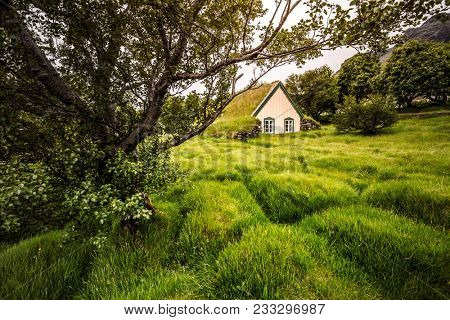 Amazing view of turf church Hofskirkja. Location place of Iceland, small village Hof, Europe. Scenic image of beautiful nature landscape. Attractive summer scene. Discover the beauty of earth.