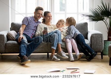 Happy Family With Children Shopping With Mobile App Together, Smiling Young Couple Buying Online Usi