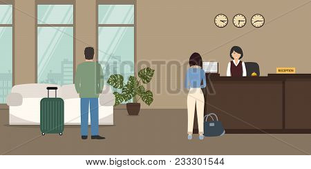 Hotel Reception. Young Woman Receptionist Stands At Reception Desk. There Is A Sofa On A Window Back