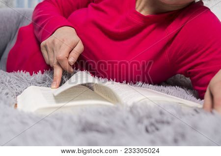 The Girl Is Reading. Hands And Book Close-up. The Concept Of Reading. A Young Woman Is Reading A Nov