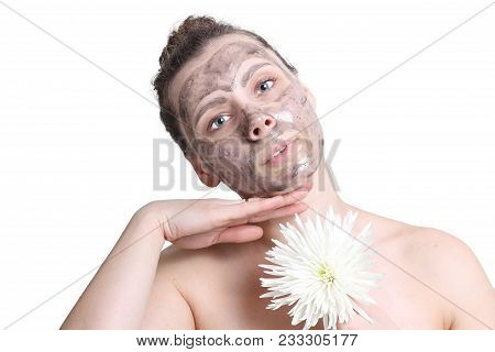 Young Attractive Girl Doing Spa Facial Treatment. Black Mask For Face. Face Cleaning. Facial Mask Fo