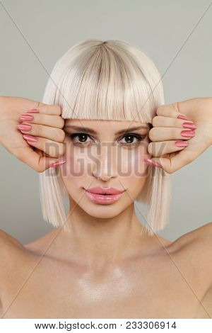 Beautiful Blonde Woman Face. Female Model With Blonde Hair, Pink Lips And Nails