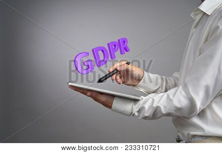 GDPR concept image. General Data Protection Regulation, the protection of personal data in European Union. Young man working with information.