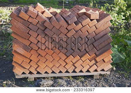 Red Bricks Pile Stack Construction Material. Close-up.