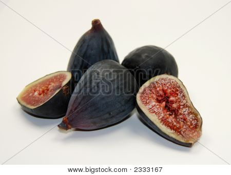 whole and split organic black mission figs from the sf farmer's market isolated on white. poster