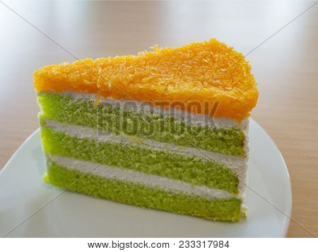 Delicious Pandan And Coconut Cake With Foi Thong (golden Threads Thai Dessert) On White Plate.