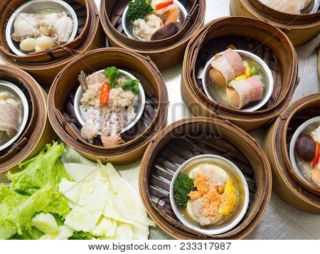 Yumcha Or Dimsum, Various Chinese Cuisine Steamed Dumpling In Bamboo Basket Steamer In Chinese Resta
