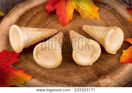 Maple Syrup Cones On A Wooden Plank. Maple Leaves In Decoration.