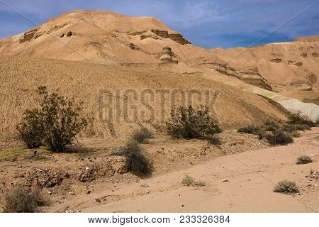 Eroded Dried Up Mud Of Sandstone Creating A Badlands Landscape Taken In Death Valley, Ca