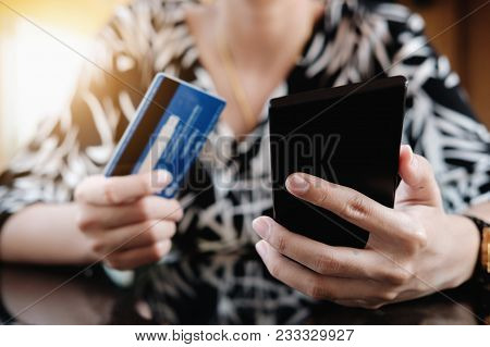 Online Payment,young Woman's Using Smart Phone And Holding Credit Card For Online Shopping.