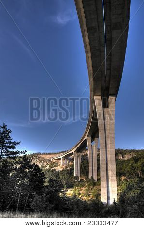 High motorway viaduct through the karst landscape poster