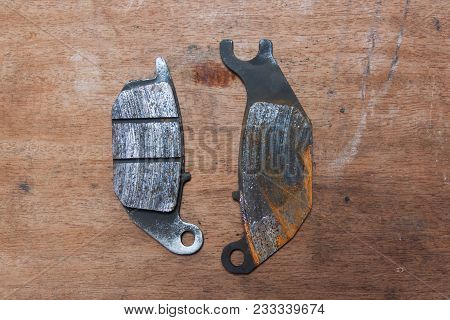 Old Rusty Brake Pad Motorcycle On Wood Background