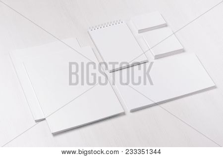 White Blank Business Card, Envelope, Brochure, Notepad, Stickers On Soft White Wood Board, Inclined.