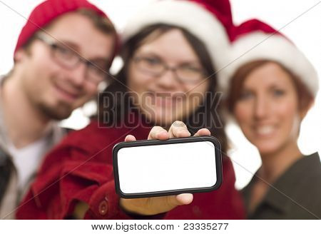 Girl with Friends and Santa Hats Holding Blank White Smart Phone - Ready for Your Own Message.