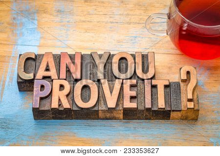 Can you prove it? A question in vintage letterpress wood type with a cup of tea..