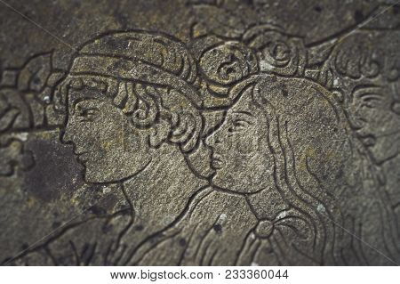 Bas-relief With A Portrait Of A Man And A Woman. Old Italian Bas-relief On A Household Theme With A