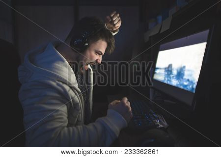 Lose In The Game On Your Computer. An Angry Gamer On The Computer At Home. A Man Playing Boro Plays