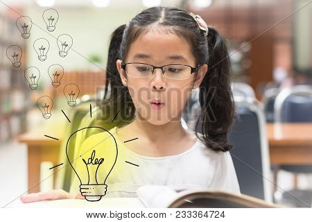Innovative Creative Idea For Copyrights Law Concept With Kid Surprised Reading Book With Lightbulb I