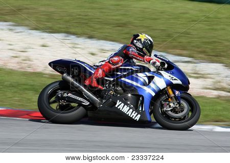 SEPANG, MALAYSIA - FEBRUARY 2: MotoGP rider Jorge Lorenzo of the Yamaha Factory Racing practices at the MotoGP winter tests at the Sepang International Circuit on February 2, 2011 in Malaysia