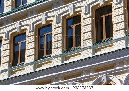 Facade Of The Building Is In Classic Style, Lit By The Sun. Architecture