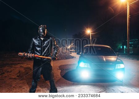 Maniac in hockey mask, baseball bat in hands