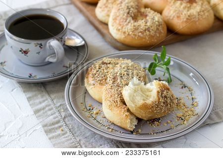 Traditional Romanian And Moldavian Sweet Buns In The Form Of Eight With Honey Glaze And Nut Crumbs.