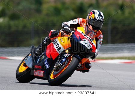 SEPANG, MALAYSIA - FEBRUARY 22: MotoGP rider Dani Pedrosa of Repsol Honda team practices at the 2011 MotoGP winter tests at the Sepang International Circuit. February 22, 2011 in Malaysia.