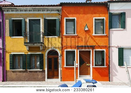 Orange And Yellow House In Burano, A Little Island In Venetian Lagoon, Italy, Europe