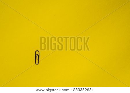 Paper Clip On Yellow Background. Text Place