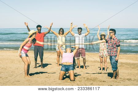 Multiracial Happy Friends Group Having Fun Together With Limbo Game At Beach - Summer Joy And Friend