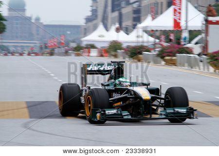 PUTRAJAYA, MALAYSIA - APRIL 2: Heikki Kovalainen of Team Lotus drives on the streets of Putrajaya in the F1 Street Demo promoting the Petronas Malaysian Grand Prix. April 2, 2011 Putrajaya, Malaysia.