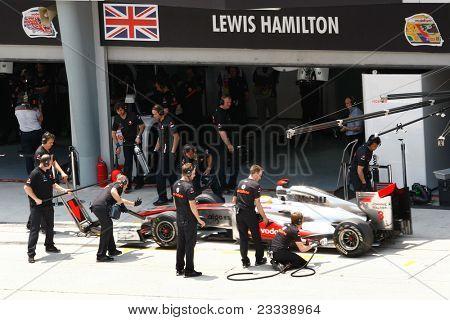SEPANG, MALAYSIA - APRIL 8: Vodafone McLaren Mercedes' mechanics practice pit stops on Lewis Hamilton's car on practice day of the Petronas Malaysian F1 Grand Prix on April 8, 2011 in Sepang, Malaysia.