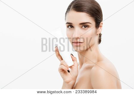 Beauty Youth Skin Care Concept - Beautiful Caucasian Woman Face Portrait Holding And Presenting Crea