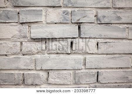 Brick wall, old brick. Pattern of the structure of a brick wall with masonry. Old wall European home
